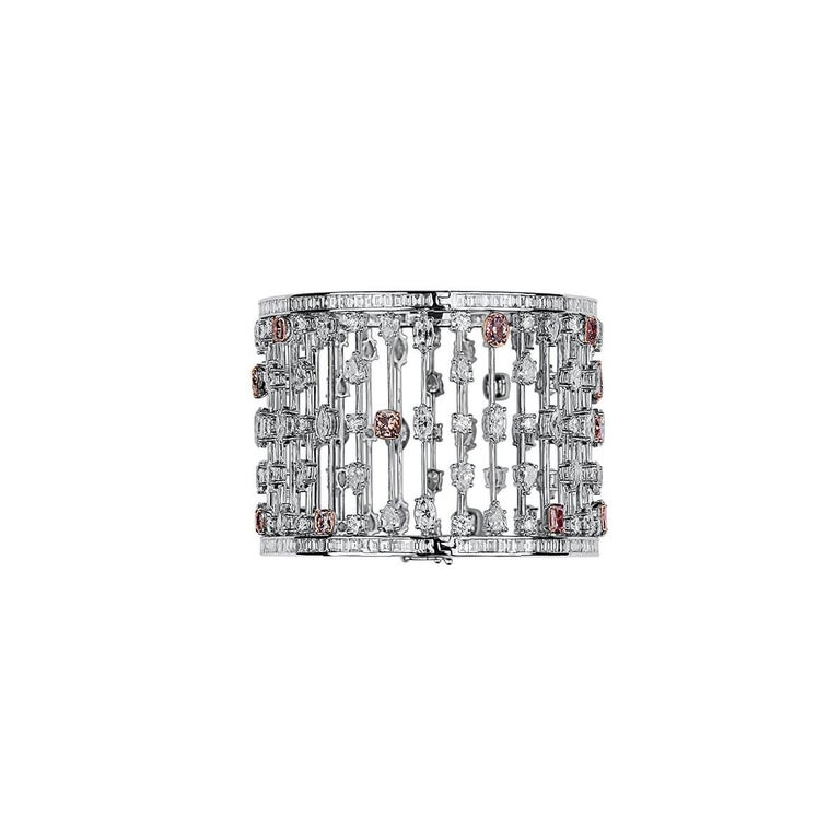 This incrediblie piece consits of the perfect mixture of natural white and pink diamonds. Together making up a total of 31.60 Carats. Sophisticated yet bold, this is GIA certified and has been expertly crafted using 18 Karat white gold.   The color