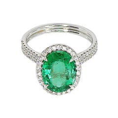 GIA Certified 3.17 Carat Oval Emerald and Diamond Halo Ring
