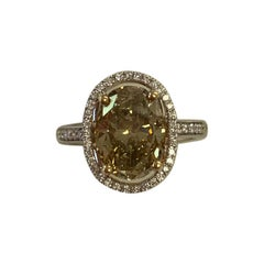 GIA Certified 3.18 Carat Natural Fancy Yellow Oval Diamond Ring 18 Karat Gold