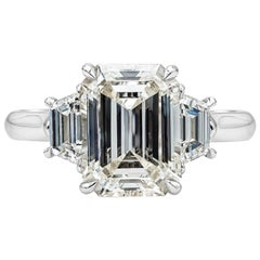 GIA Certified 3.21 Carat Emerald Cut Diamond Three-Stone Engagement Ring