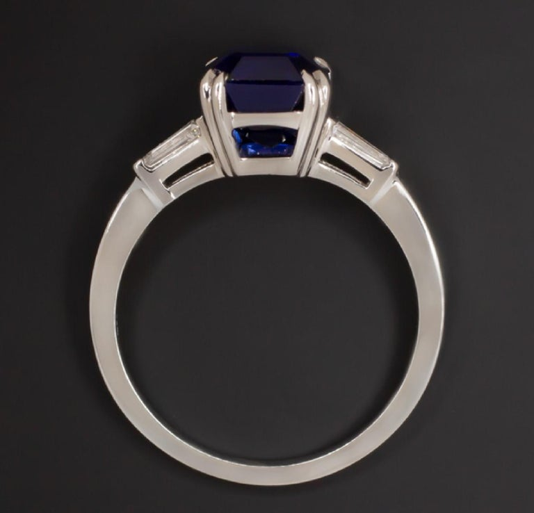 Sophisticated sapphire and diamond ring features a gorgeous emerald cut royal blue sapphire accented by tapered baguette cut diamond accents. The color of the 3.13ct GIA certified sapphire is absolutely stunning with a rich, velvety blue play of