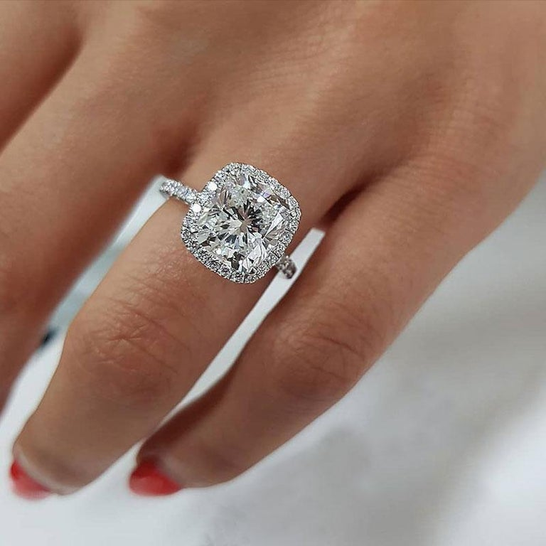 This gorgeous 4.50 Carat GIA certified cushion cut diamond ring is completely eye clean, bright white, and it sparkles stunningly with vibrant brilliance! Well cut, the diamond's sparkle is bright and well defined rather than the crushed ice look
