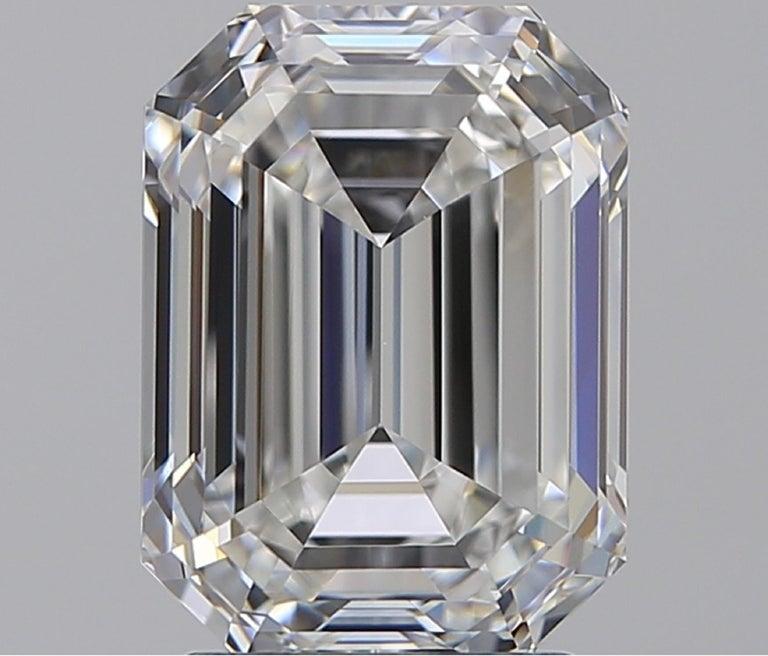 Modern GIA Certified 4 Carat Three-Stone Emerald Cut Diamond Ring For Sale