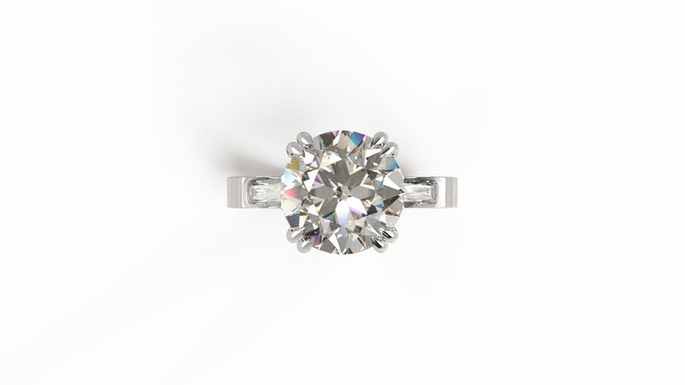 This stunning 3.50 carat diamond engagement ring with trapezoid diamonds on the sides. With an elegant platinum setting with a raised profile and eight prongs, this 3.50 carat diamond ring is gorgeous  Please be advised that we custom make all of