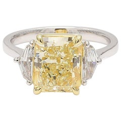 GIA Certified 3.51 Carat Yellow Radiant Cut Center with Two White Half Moons
