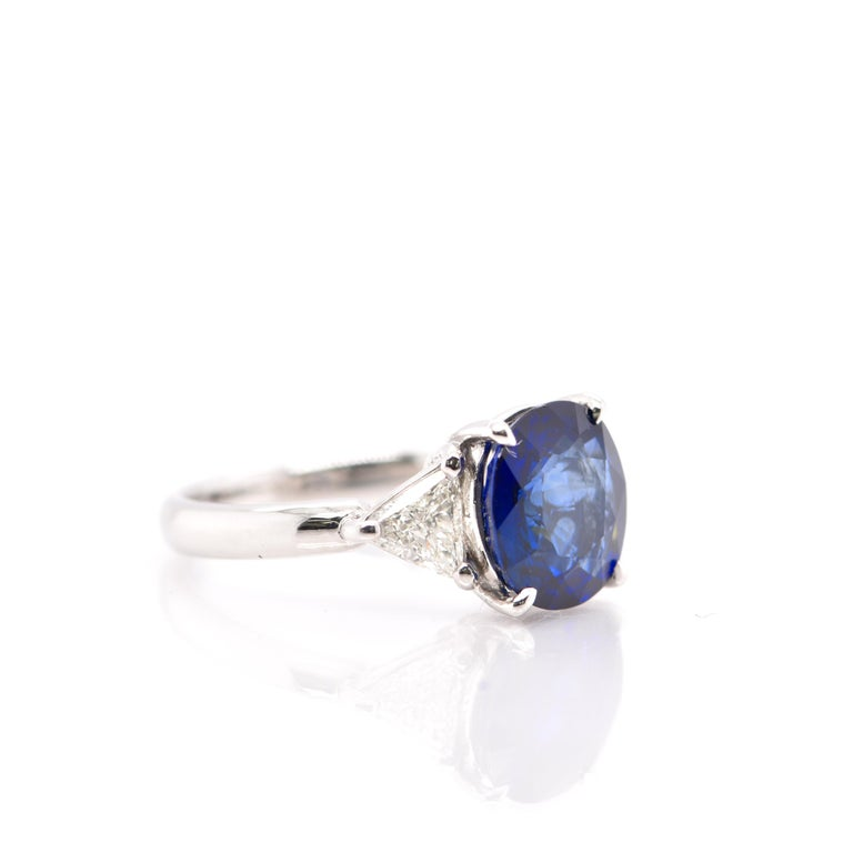 Modern GIA Certified 3.53 Carat Madagascar Sapphire and Diamond Ring Set in Platinum For Sale