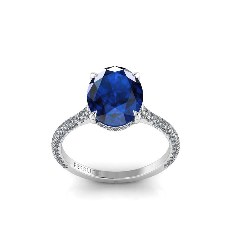 GIA Certified 3.55 carat from Madagascar, blue Oval Sapphire,  conceived in an hand made Platinum ring, adorned with a shower of ultra white diamonds, hand set on almost every surface to give the maximum light reflection and sparkle. The total carat