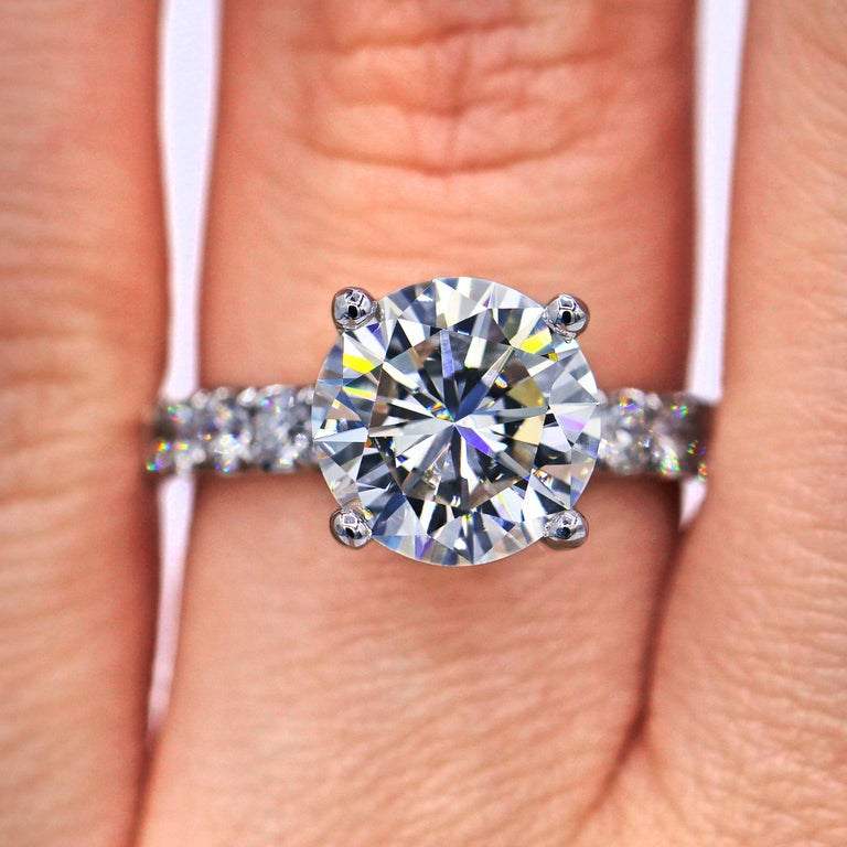 Platinum Round Brilliant Cut Engagement Ring, features 3.61 Carat GIA Certified Round Shape Diamond E color SI2 in clarity, set with 14 round brilliant cut diamonds totaling 1.15 carats.