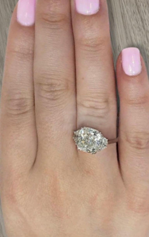 A Really amazing diamond.  The main stone is a beautifull Cushion Cut Diamond Certified by GIA