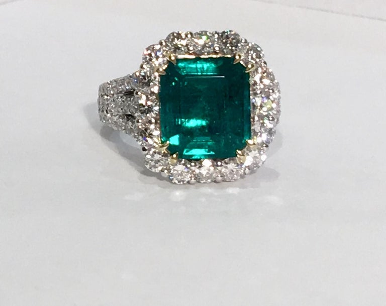 Magnificent, finest quality 18 karat white gold ring features a GIA certified, F1, octagonal step cut, transparent green Colombian emerald weighing 3.69 carats and measuring 10.94 mm x 9.73 mm x 4.72 mm. GIA certificate #1176234276. The emerald is