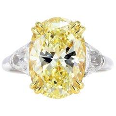 GIA Certified 3.77 Carat Oval Fancy Light Yellow Diamond Ring