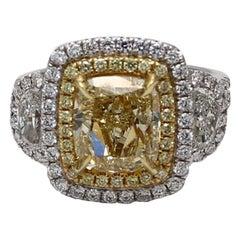 GIA Certified 3.80 Carat Fancy Yellow Cushion 3 Stone Double Halo 18k Gold Ring