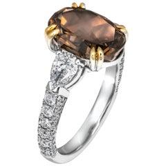 GIA Certified 3.81 Carat Oval Fancy Brown-Orange Diamond Three-Stone Ring