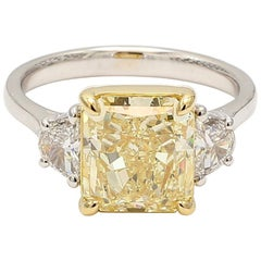 GIA Certified 3.84 Carat Yellow Radiant Cut Center Two GIA Shields Diamond Ring