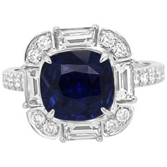 GIA Certified 3.85 Carat No Heat Blue Sapphire Diamond Halo Gold Cocktail Ring