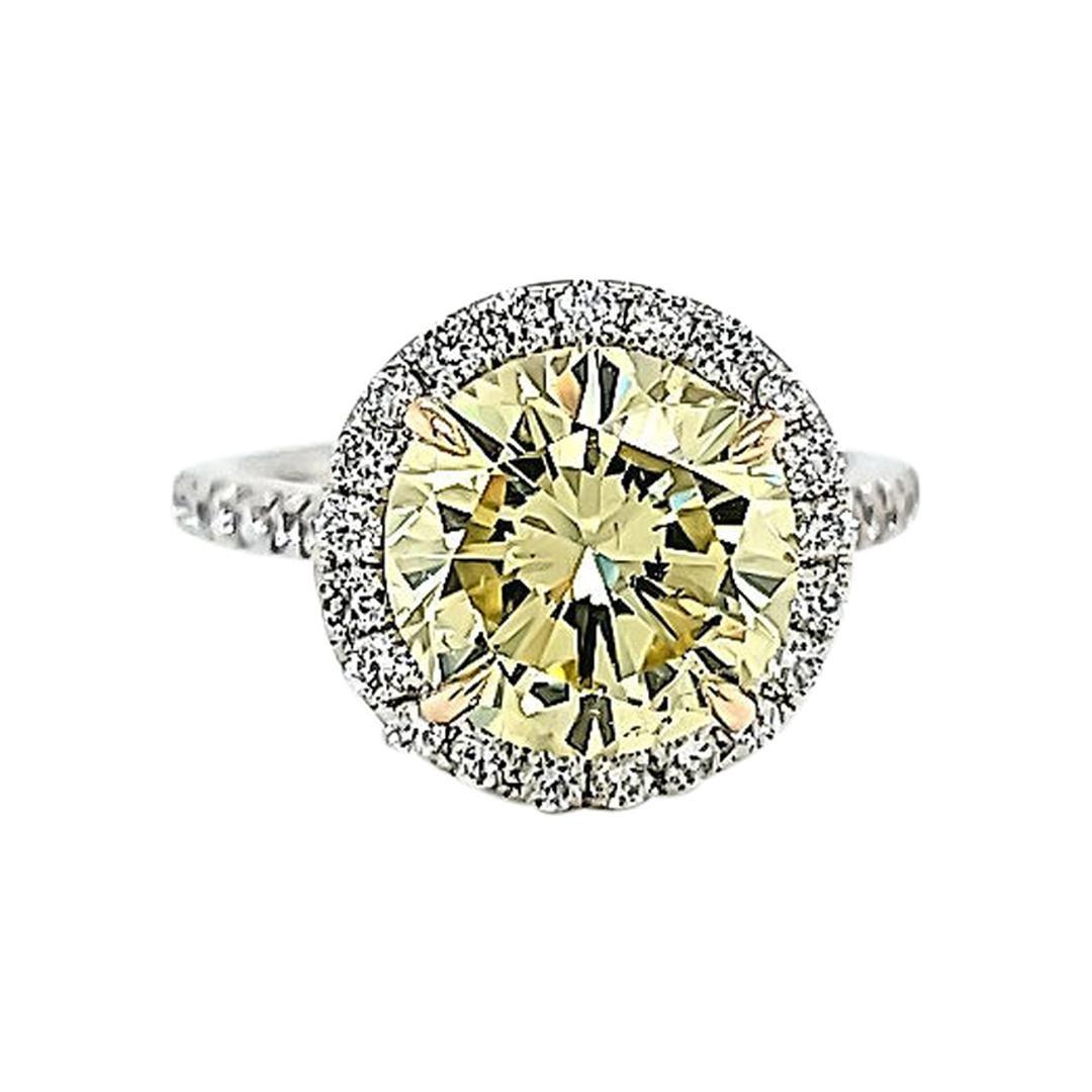 GIA Certified 3.87 Carats Fancy Yellow Diamond Ring