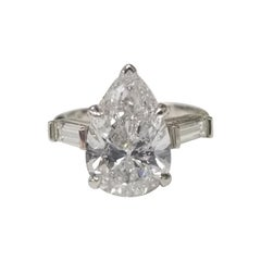 GIA Certified 3.95cts. Pear Shape Diamond Color E with 2 Baguettes .50pts