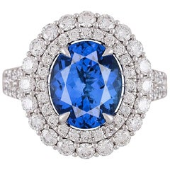 GIA Certified 3.97 Carat Oval Cut Tanzanite and Diamond Halo Ring in 18K Gold