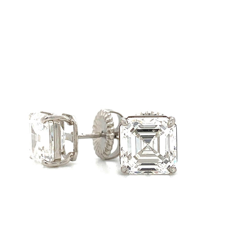 These astonishing matching pair of asscher cut (square emerald) cut diamond studs from Issac Nussbum New York are mounted in hand made platinum.Graded by the GIA to be F-G color VS2 clarity.  And weigh over 4 carats each.   This pair of
