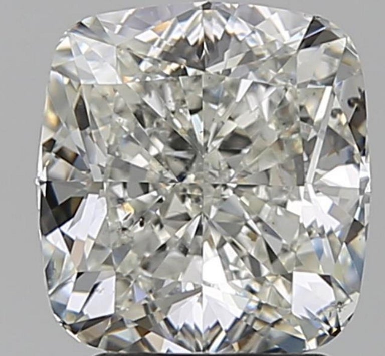 A really amazing diamond. The main stone is certified by GIA  I Color white faced SI1 Clarity 100% EYE CLEAN and Triple excellent cut