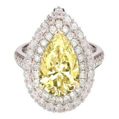 GIA Certified 4 Carat Double Prong Fancy Light Yellow Diamond 18 Carat Gold Ring
