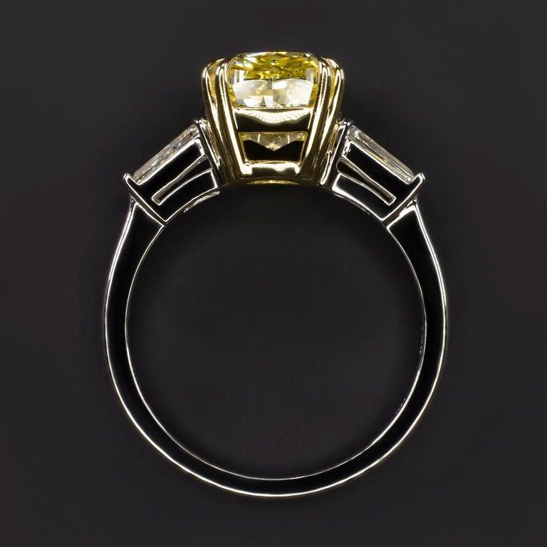 Modern GIA Certified 4 Carat Fancy Intense Yellow Cushion Diamond Platinum Ring For Sale