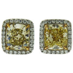 GIA Certified 4 Carat Fancy Yellow Diamond Studs in Platinum and 18 Karat Gold