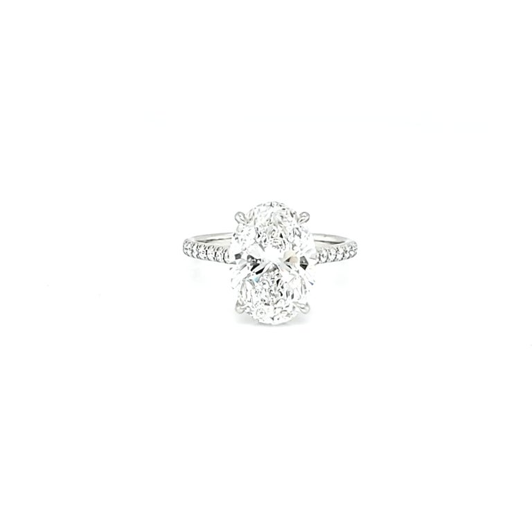 Center stone is a GIA certified 4 carat D color Si2 clarity set in a ultra thin micro pave platinum setting. Additional 0.25 carats of matching color and clarity round diamonds. 1.42 length to width ratio makes this a perfectly shaped and sought