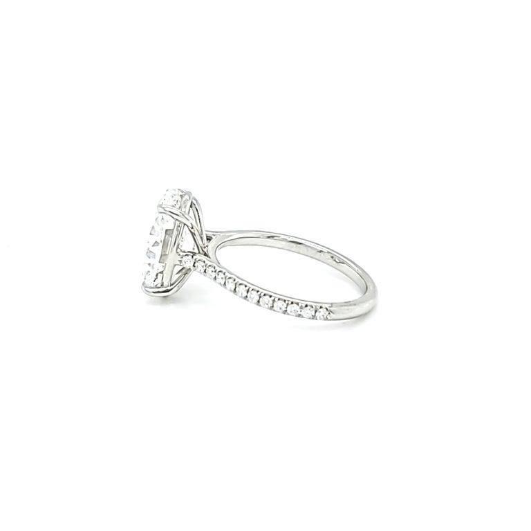 Women's GIA Certified 4 Carat Oval Cut Diamond Ring