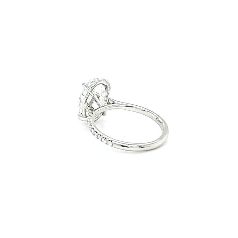 GIA Certified 4 Carat Oval Cut Diamond Ring 1