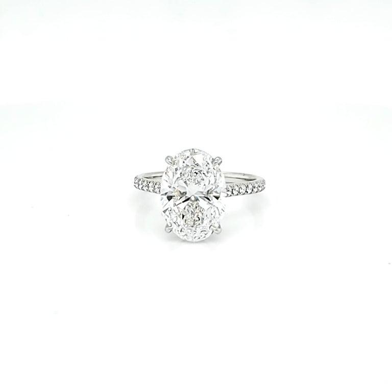 GIA Certified 4 Carat Oval Cut Diamond Ring 2