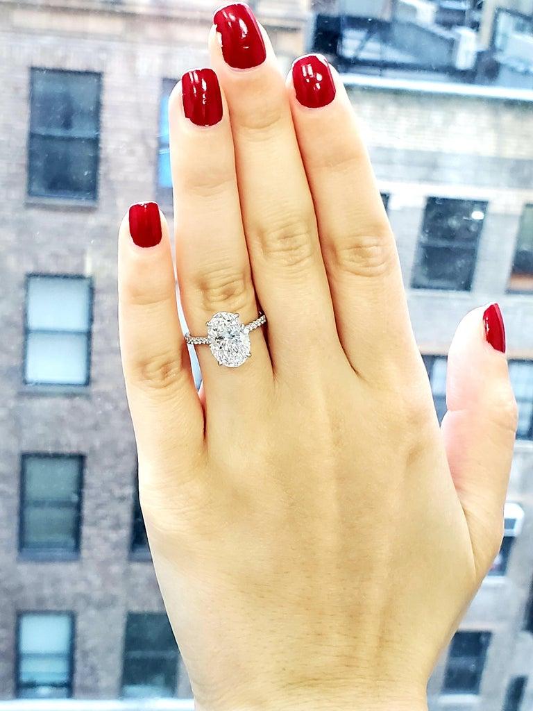 GIA Certified 4 Carat Oval Cut Diamond Ring 3