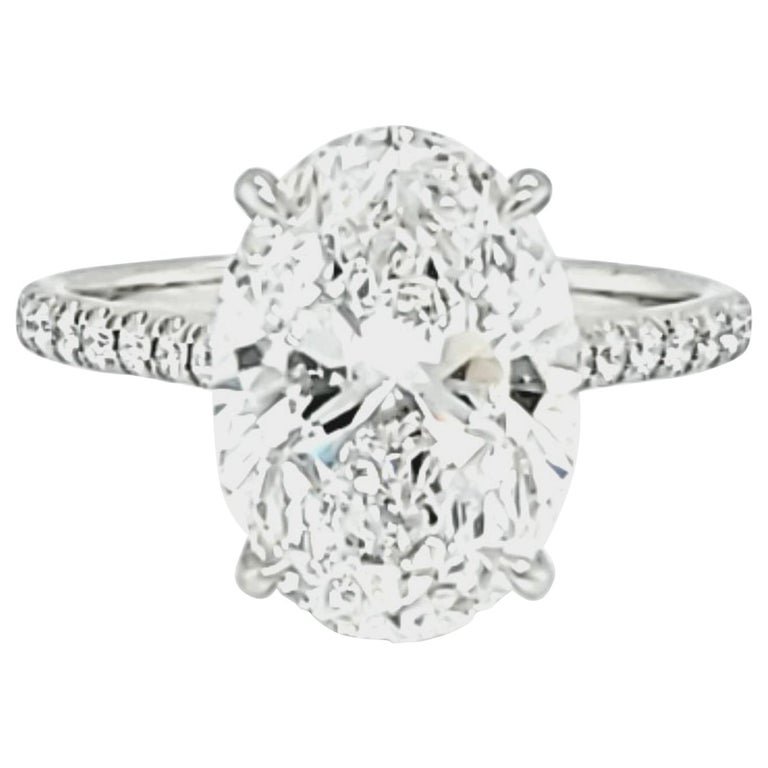 GIA Certified 4 Carat Oval Cut Diamond Ring