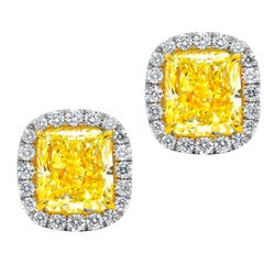 GIA Certified 4.00 Carat Cushion Cut Fancy Yellow Diamond Stud Earrings