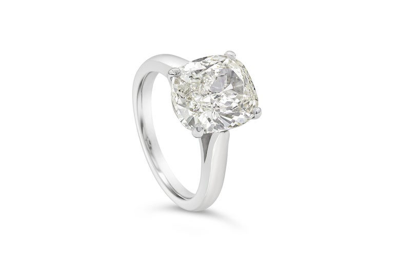 A classic engagement ring style showcasing a 4.01 carat cushion cut diamond certified by GIA as J color, SI2 clarity, set in a rounded platinum mounting.   Style available in different price ranges. Prices are based on your selection. Please contact