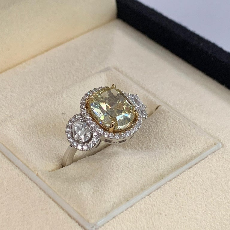 GIA Certified 4.01 Carat Fancy Yellow Cushion Cut Diamond Ring In Excellent Condition For Sale In Great Neck, NY