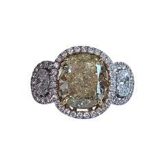 GIA Certified 4.01 Carat Fancy Yellow Cushion Cut Diamond Ring