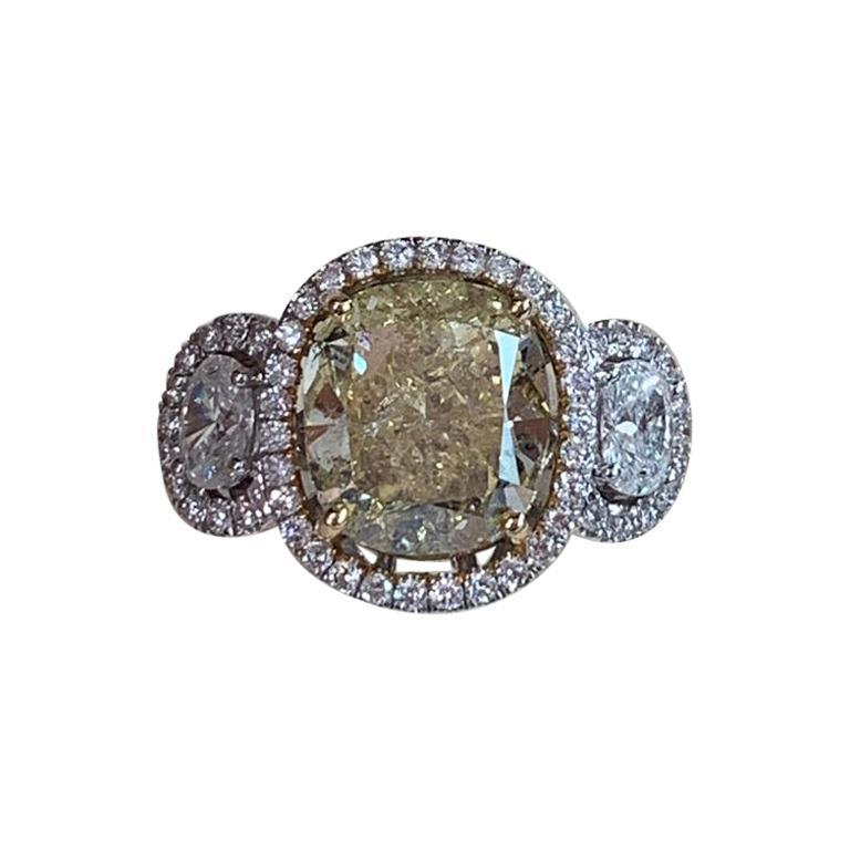 GIA Certified 4.01 Carat Fancy Yellow Cushion Cut Diamond Ring For Sale