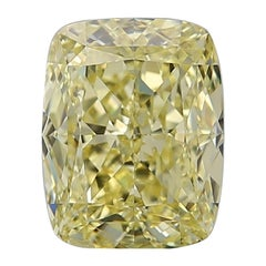 GIA Certified 4.01 Carat Fancy Yellow Cushion Diamond