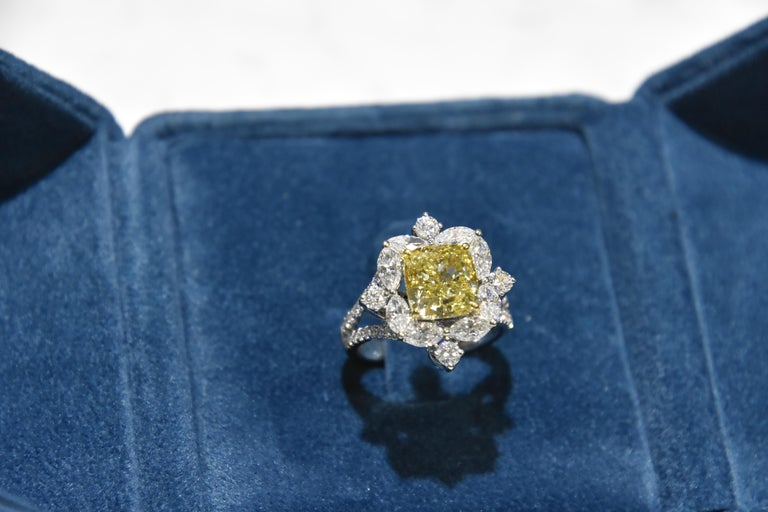 Contemporary classic designed ring featuring a 4.01 carat cushion cut Fancy greenish yellow diamond ring with D-F vvs- vs quality white diamond finished in white gold.   Center stone certified by world wide known GIA institution. Ring size- US 6,