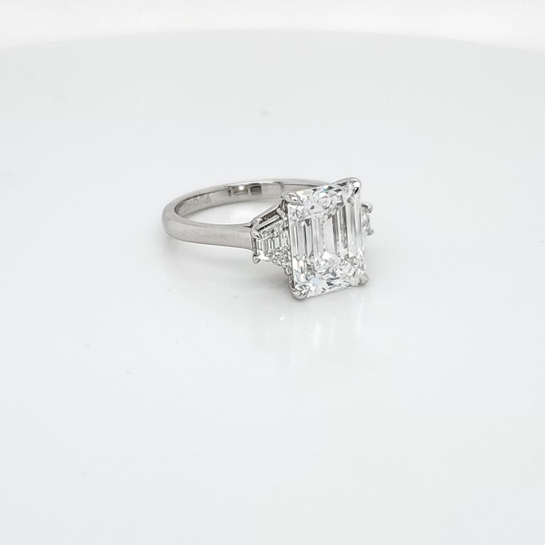 GIA Certified 4.02 Carat Emerald Cut Three-Stone Ring In New Condition For Sale In New York, NY