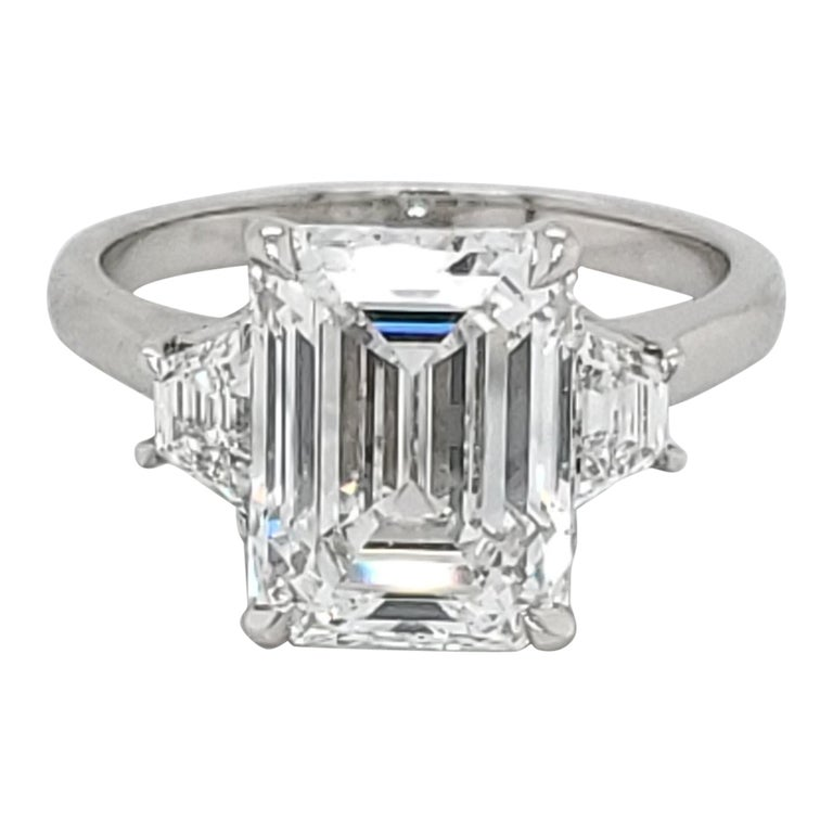 GIA Certified 4.02 Carat Emerald Cut Three-Stone Ring For Sale