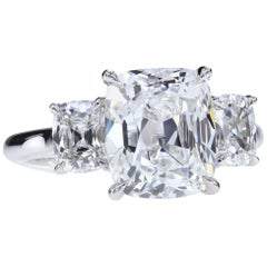 GIA Certified 4.02 Carat F/VVS2 Antique Cushion Diamond Three-Stone Ring