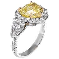 GIA Certified 4.02 Carat Fancy Yellow Heart Shape Three-Stone Ring