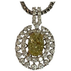 GIA Certified 4.06 Oval Yellow Center and White Diamond Pendant