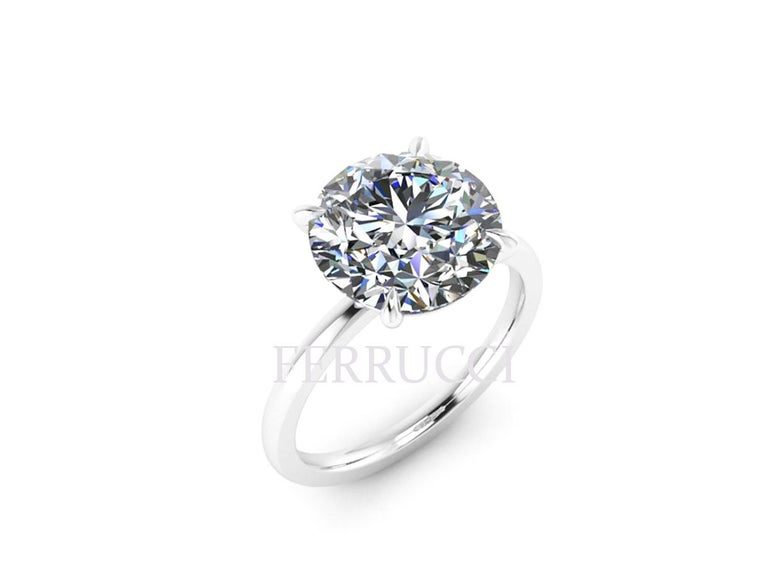 GIA Certified 4.09 carat, H color, VS1 clarity, no Fluorescence set low in a low setting style, platinum 950 solitaire ring. Custom options for diamonds and settings are always available.  Ring size is 5  3/4 that can be sized upon order  Our
