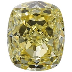 GIA Certified 4.16 Carat Fancy Intense Yellow Cushion Diamond VVS1