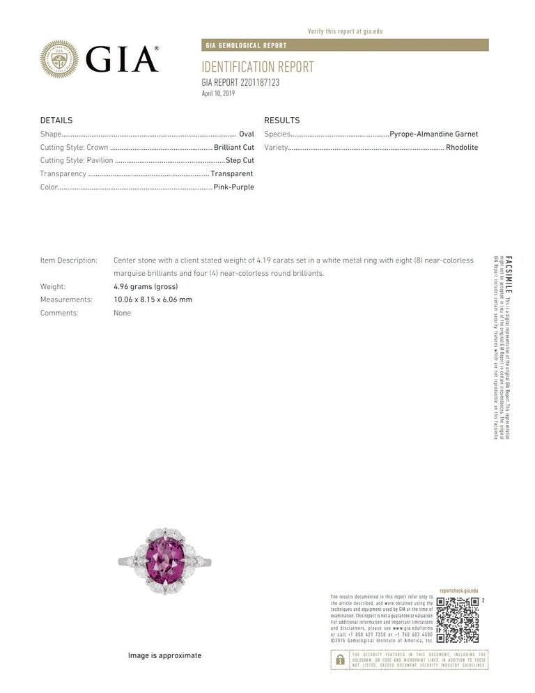 With a GIA Certified 4.19 carat oval cut exotic garnet center, set inside a halo of marquise cut white diamonds (total diamond weight 0.68 carats), this ring shines from every angle.  GIA Certification details (see photo): The center garnet is