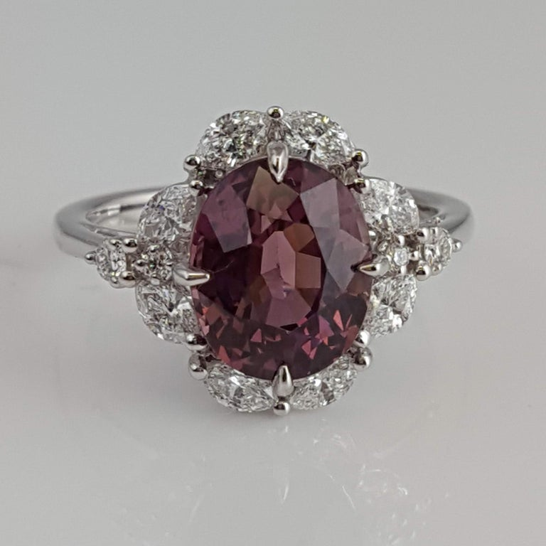 Contemporary GIA Certified 4.19 Carat Oval Cut Exotic Pink-Purple Garnet and Diamond Ring For Sale