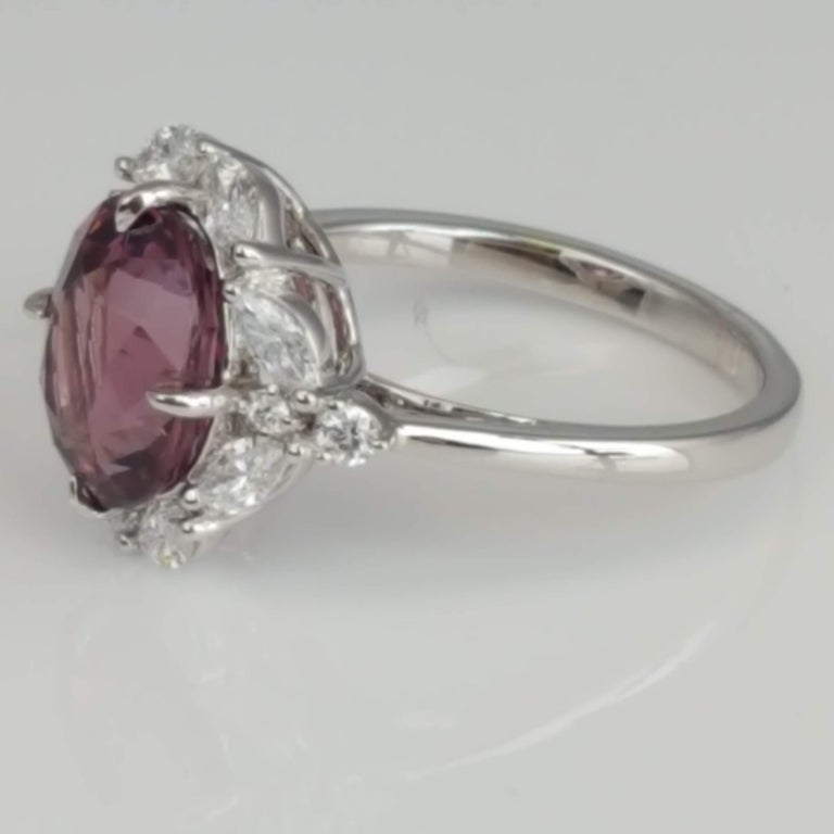 GIA Certified 4.19 Carat Oval Cut Exotic Pink-Purple Garnet and Diamond Ring In New Condition For Sale In New York, NY